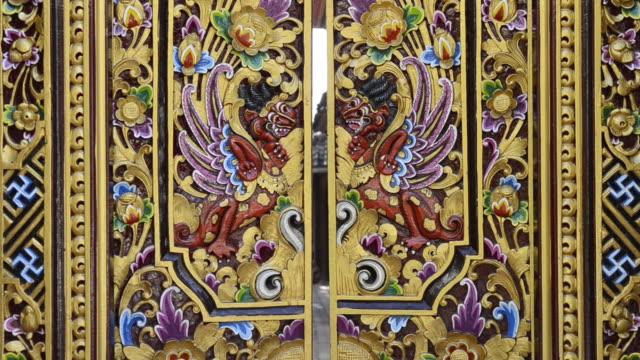 cu shot of woodcarving house entrance door / ubud, bali, indonesia    - ubud district stock videos & royalty-free footage