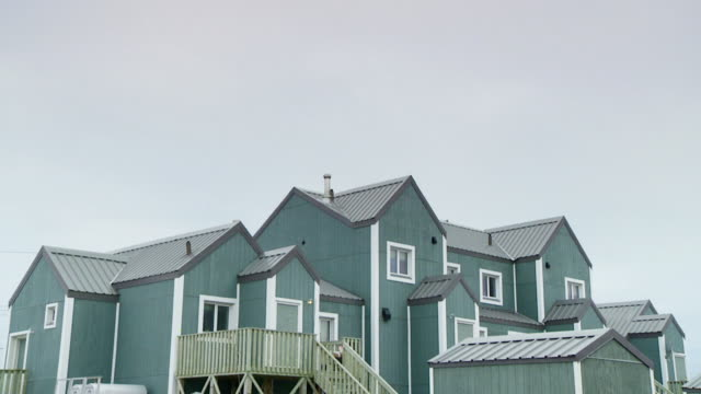ws td shot of wooden home with speed boats / arviat, nunavut, canada - wiese stock videos & royalty-free footage