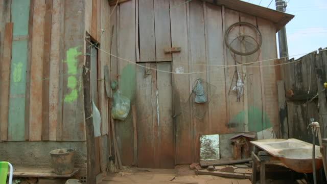 MS Shot of wooden house in village / Serra Pelada, Para, Brazil
