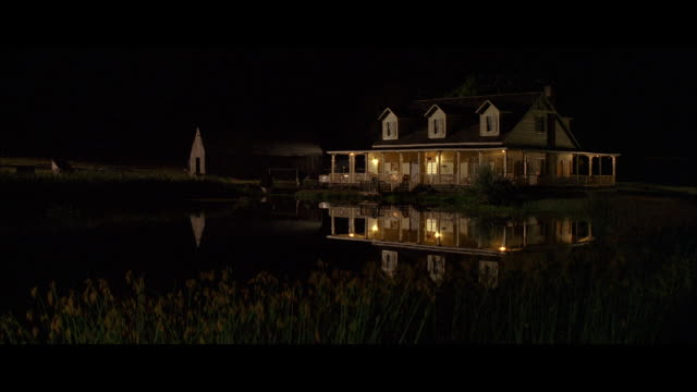 vidéos et rushes de ws shot of  wooden older farmhouse and weather beaten wood barn at night / unspecified - establishing shot