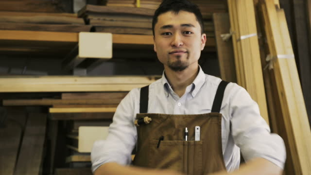 vidéos et rushes de ms shot of woodworker standing in his work station / kyoto, japan - bois