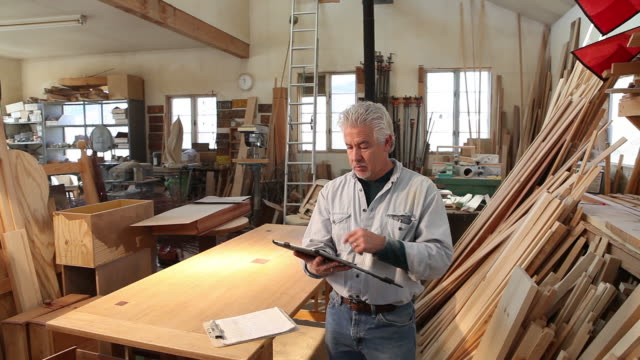 ms shot of woodworker using tablet in his work station / lamy, new mexico, united states - lamy new mexico stock videos & royalty-free footage