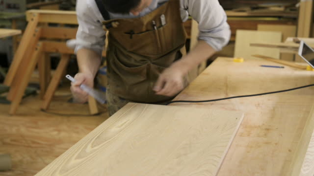 MS Shot of woodworker working in his work station / Kyoto, japan