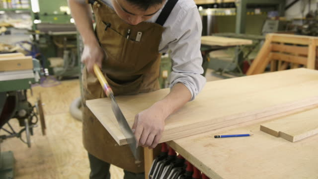 ms shot of woodworker working in his work station / kyoto, japan - hand saw stock videos and b-roll footage