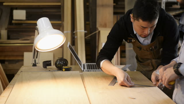 ms shot of woodworkers of two people have meeting / kyoto, japan - electric lamp点の映像素材/bロール