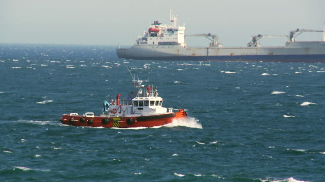 ms ts shot of work boat mediterranean sea / spain - tugboat stock videos and b-roll footage