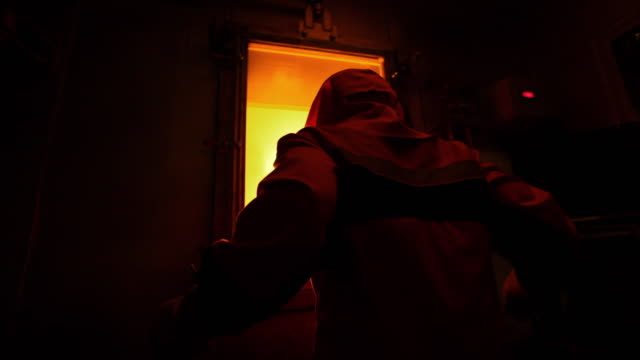 shot of worker with fire retardant clothing watching blast furnace - blast furnace stock videos & royalty-free footage