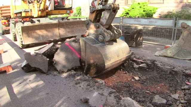 ms shot of workmen engraving on street for works at sewage pipe / saarburg, rhineland palatinate, germany - excavator stock videos and b-roll footage