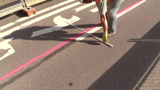 vídeos de stock, filmes e b-roll de ms shot of workmen working for measurement on street at sewage pipe / saarburg, rhineland palatinate, germany - medindo