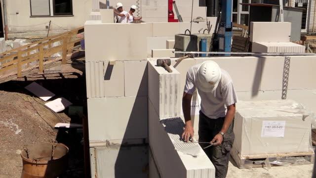 MS Shot of workmen working measurement at house construction / Hermeskeil, Rhineland-Palatinate, Germany