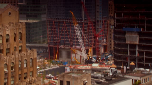 ms tu shot of world trade center building under construction to top of building structure with construction cranes / new york, united states - one world trade center stock-videos und b-roll-filmmaterial
