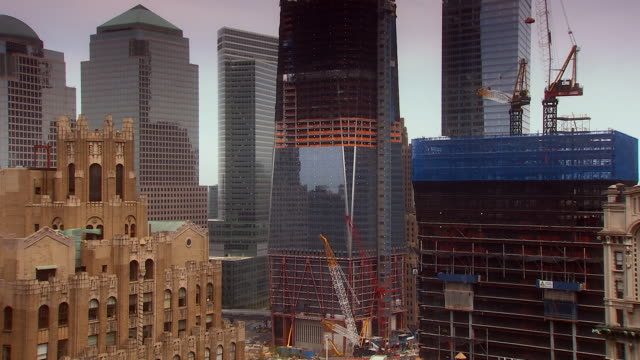 ms tu shot of world trade center building under construction with construction cranes and buildings surrounding / new york, united states - one world trade center stock videos & royalty-free footage