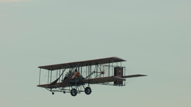 ms ts aerial shot of wright b flyer airplane flying in air with clouds in sky / dayton, ohio, united states - wright flyer stock-videos und b-roll-filmmaterial