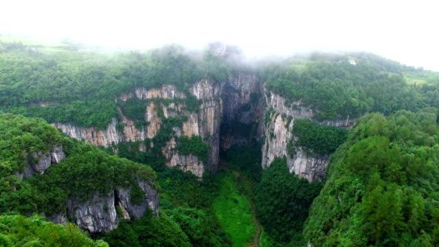 WS AERIAL shot of Wulong Karst Landform with heavy fog,Chongqing, China