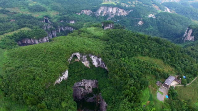 ws aerial shot of wulong karst landform,chongqing, china - rock face stock videos and b-roll footage