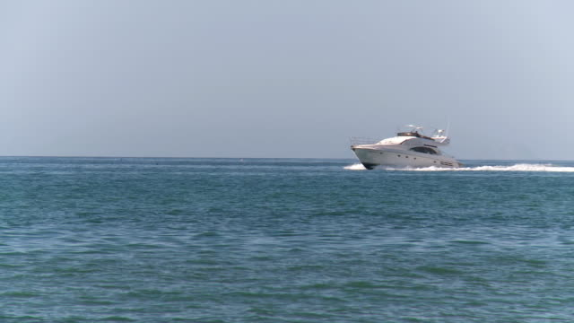 MS Shot of Yacht moving ahead in sea / Marbella, Andalusia, Spain
