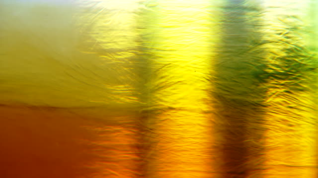 ecu shot of yellow and orange liquids move and separate into different shapes and colors in container / falls church, virginia, united states   - falls church stock videos & royalty-free footage