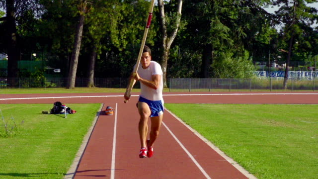 hd shot of young adult man at pole vaulting - pole stock videos & royalty-free footage
