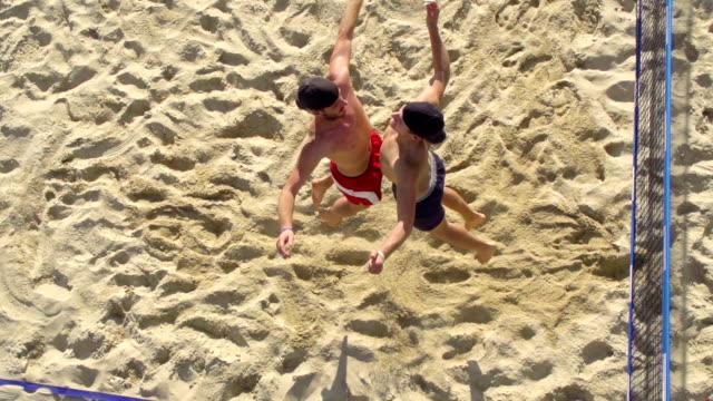 HD-Aufnahme von jungen Strand Volley Spieler anlässlich des preisgekrönten Point
