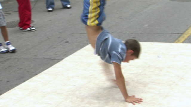 MS TS Shot of young boy break dancing at Busker Fest / Toronto, Ontario, Canada