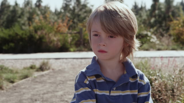 cu shot of young boy stares thoughtfully / beaverton, oregon, united states - staring stock videos & royalty-free footage