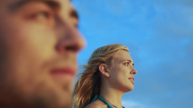 ecu r/f shot of young couple gazing into distance, ocean sunset at santa monica / venice, california, united states  - admiration stock videos and b-roll footage