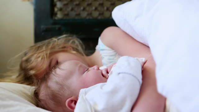 cu shot of young girl cuddling with her baby brother / lamy, new mexico, united states - lamy new mexico stock videos & royalty-free footage