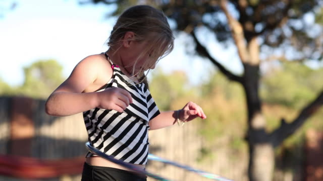 ms shot of young girl hula hooping near pool / lamy, new mexico, united states - lamy new mexico stock videos & royalty-free footage