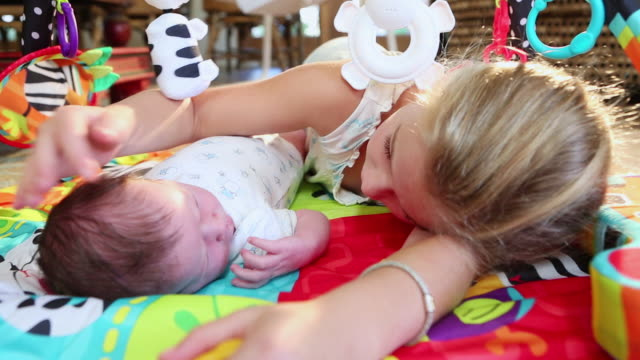 cu shot of young girl lying with her baby brother / lamy, new mexico, united states - lamy new mexico stock videos & royalty-free footage
