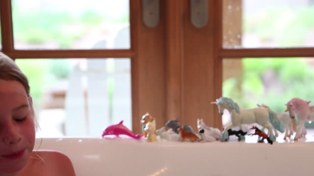 ms shot of young girl playing in bath tub / lamy, new mexico, united states - bathroom stock videos & royalty-free footage