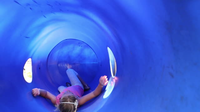 ms td shot of young girl playing in blue tunnel at playground / lamy, new mexico, united states - lamy new mexico stock videos and b-roll footage