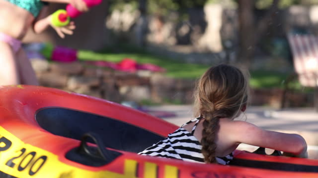 ms shot of young girl playing on float in pool / lamy, new mexico, united states - lamy new mexico stock videos & royalty-free footage