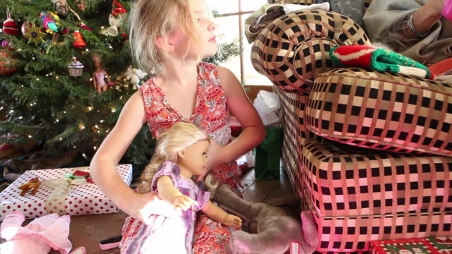 ms tu shot of young girl playing with her new doll on christmas / lamy, new mexico, united states - lamy new mexico stock videos & royalty-free footage