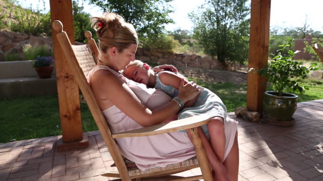 MS Shot of young girl resting on her pregnant mothers lapy and young girl get up and go away / Phoenix, Arizona, United States