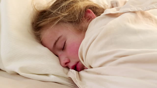 cu pan shot of young girl sleeping in her bed / lamy, new mexico, united states - lamy new mexico stock videos & royalty-free footage
