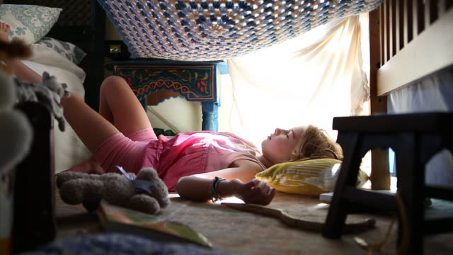MS Shot of young girl sleeping on her bedroom floor / Santa Fe, New Mexico, United States