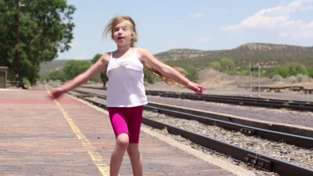 ms shot of young girl spinning around at train station / lamy, new mexico, united states - lamy new mexico stock videos & royalty-free footage