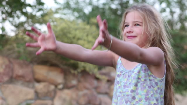 ms shot of young girl throwing football / lamy, new mexico, united states - 投げる点の映像素材/bロール