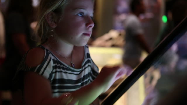 ms tu td shot of young girl using touchscreen at museum / dallas, texas, united states - museum stock videos & royalty-free footage