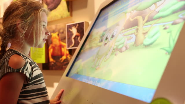 ms shot of young girl using touchscreen at museum / dallas, texas, united states - touch screen stock videos & royalty-free footage