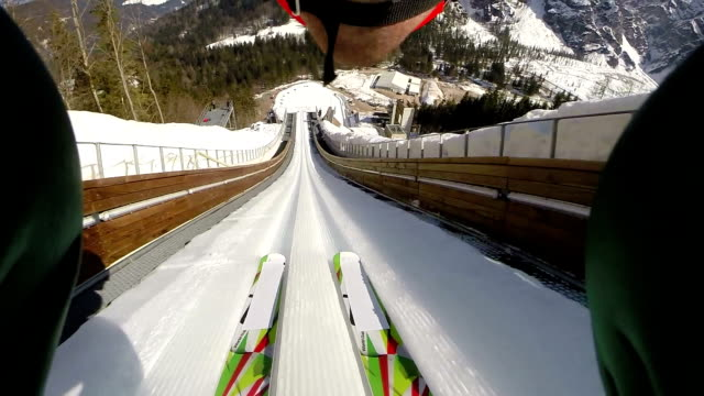 hd: shot of young man at ski jumping - winter sport stock videos and b-roll footage