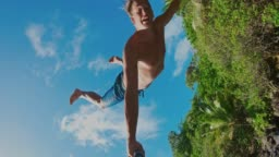 POV shot of young man cliff jumping
