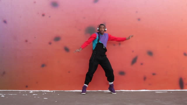 MS Shot of young man dancing in urban area / Minneapolis, Minnesota, United States