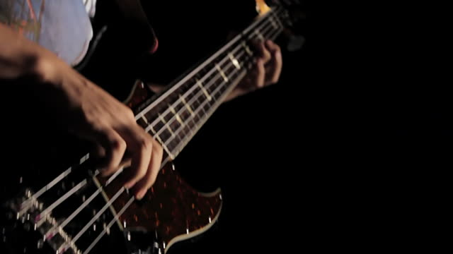 ms cu shot of young man playing bass guitar / shinjuku, tokyo, japan - bass guitar stock videos & royalty-free footage