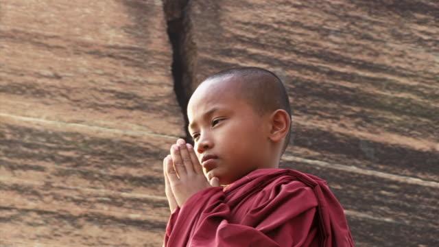 CU Shot of young monk praying  / Mandalay, Mandalay Division, Myanmar