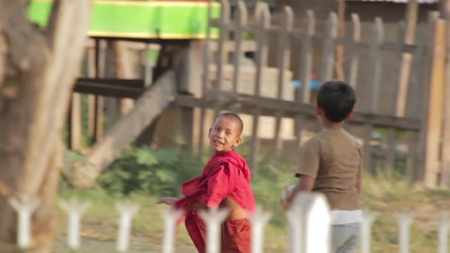 ws ts shot of young monks carrying soccer ball, getting into position for game / inle lake, shan state, myanmar   - shan state stock videos & royalty-free footage