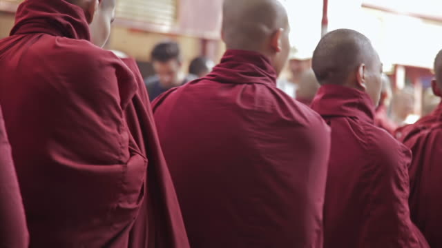 ms shot of young monks walking in line to get their meal  / mandalay, mandalay division, myanmar - photography themes stock videos & royalty-free footage