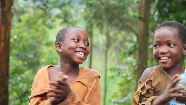 MS PAN Shot of young ugandan boys sing and clap to on native song AUDIO / bwindi, kabale, uganda