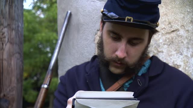 cu tu shot of young union soldier writes letter  / middleburg, virginia, united states - unionsarmén bildbanksvideor och videomaterial från bakom kulisserna