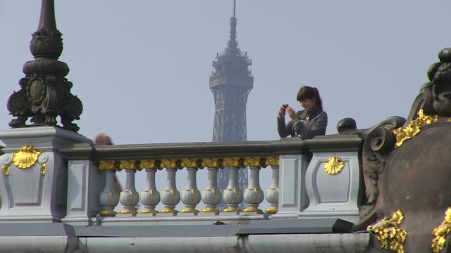 ms shot of young woman taking picture at ponte alexandre iii / paris, ile de france, france - ponte stock videos & royalty-free footage